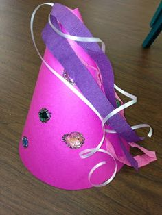Princess hat made with poster board, crepe paper, ribbon, and gems!