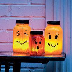 Jar-o'-lanterns... These would look so cute all along a window ledge!