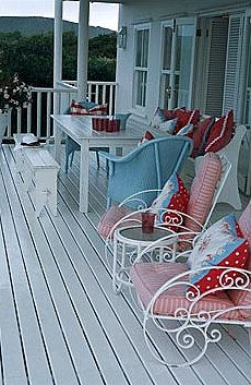 aqua and red accessories on the porch   -   These chairs are so pretty.  Love the red and blue theme.