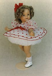 Shirley Temple, Lawton Doll company - I have my mom's doll which looks a bit like this one, so say 30's or so, and mine which is from the late 50's!
