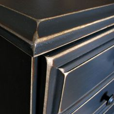 Annie Sloans chalk paint in graphite, distressed edges and added a coat of poly. before and after