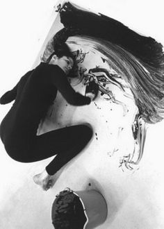 "Loving Care, 1992 by Janine Antoni  ""Performance of her dipping her hair in hair dye and painting the gallery floor"""