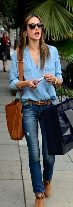 Who made  Alessandra Ambrosio's tan suede boots, skinny jeans, denim shirt, brown belt, and handbag?