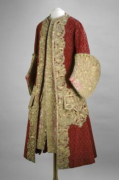 Coat and waistcoat, France. About 1729. Coat: silk velvet, trimmed with gold lace. Waistcoat: silver brocade, trimmed with gold lace.
