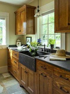 Gorgeous white pine cabinets and dark stone farmhouse sink in this cottage-style kitchen on HGTV.com.