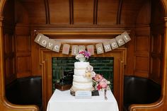 Four tier rustic wedding cake topped with a vintage teacup filled with flowers | Photography by http://www.caroweiss.com/