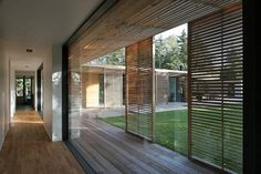 Love the use of wooden sliding doors/shutters. Perfect for balconies which need to have multiple uses.