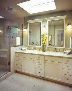 like the half wall into shower, double mirror/vanity