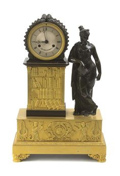An Empire Style Gilt and Patinated Bronze Figural Mantel Clock, Height 17 1