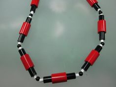 ART DECO INSPIRED NECKLACE IN PLASTIC AND GLASS. www.simonmower.com
