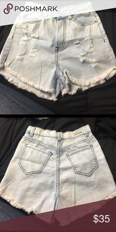 J. Creations high rise shorts NWOT high rise shorts have a color washed to it(very light blue) holes in the front are made by designer. J. Creations Shorts Jean Shorts