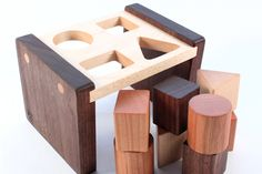 shape sorter $45 http://smilingtreetoys.com/collections/toys/products/shape-sorter