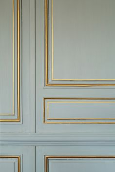 Blue walls with gilded molding                                                                                                                                                                                 More
