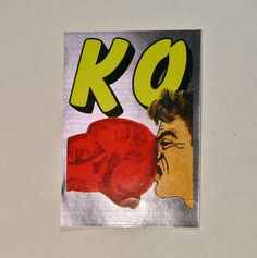 This is a rare vintage 1987 foil vending machine sticker with an illustration of a boxer being punched in the face with a boxing glove over the
