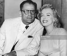 American actress Marilyn Monroe (1926 - 1962) with her husband, playwright Arthur Miller at London Airport, 14th July 1956. Monroe is in London to begin filming 'The Prince and the Showgirl' with Laurence Olivier.