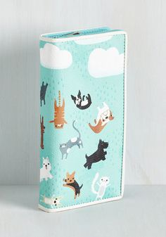 Expect precipitation in the form of compliments when you show off this sky blue wallet, because when it rains, it 'purrs!' Printed with a storm of cats and dogs, this vegan faux-leather pocketbook has a zippered cash compartment and plenty of space for cards, making personal organization a 'fur-shionable' affair.