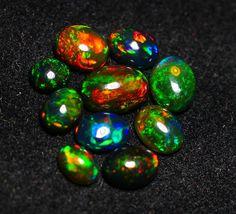 Parcel smocked black opal Welo Opal, Opal Auctions, Black Opal, Ethiopia, Smocking, Maya, Bright, 9 Mm, Stone
