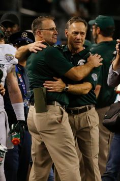 Dantonio and Narduzzi embrace following the Cotton Bowl victory.