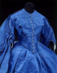 Beautiful! I love the tasseled trim.    Dress | V Search the Collections