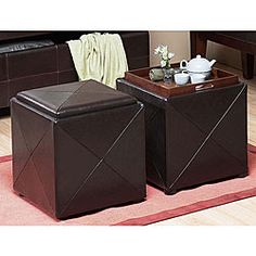 @Overstock.com - Chocolate Synthetic Leather Storage Cube with Wood Serving Tray - This contemporary storage cube makes a great accent in any room. The compact ottoman provides almost 3 cubic feet of storage.  http://www.overstock.com/Home-Garden/Chocolate-Synthetic-Leather-Storage-Cube-with-Wood-Serving-Tray/4425003/product.html?CID=214117 $89.99