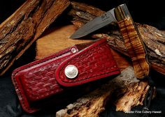 Pocket knife in hand-tooled belt sheath. Hand-forged VG10 stainless damascus blade, stainless steel bolster, titanium liners, koa wood handle. Salter Fine Cutlery. Made in Hawaii.