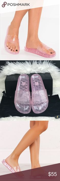 NWT Fenty Puma Jelly Slide WMNS Brand new with box. Price is firm! No trades. Introducing a new slide to the FENTY PUMA BY RIHANNA Collection. The Jelly Slide features a PUMA logo on a textured, all over Jelly Strap and a whimsical diamond pattern outsole. PUMA logo on Jelly Strap FENTY PUMA by Rihanna on lateral side Translucent jelly tone Puma Shoes Slippers
