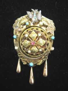 Victorian pin with turquoise stones