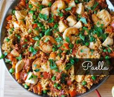 An easy chicken paella recipe with shrimp. This seafood dish with crunchy paella rice is great for parties.