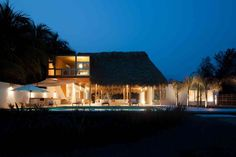 colorful-tropical-open-home-rough-cut-thatched-roof-2-main-view-night.jpg
