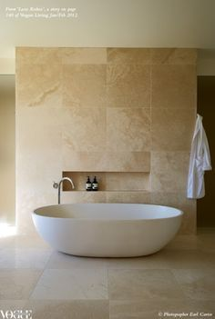 Travertine tiles are a personal favourite as they are soft and timeless. The niche above the freestanding bath is also a nice area to place products.