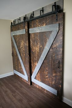 Custom Double Bypass Z Plank Barn Door room divider for Andrea Joy Photography Studio, Greenville, SC. Solid 2x10 Eastern White Pine Design , build and installation by Original Woodcraft, © Copyright Clint Gray 2017