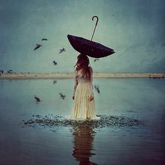The work of American fine art photographer Brooke Shaden is, as she says, a way to create new worlds where the impossible becomes possible. Floating women, fairy tales, transparent cloths, dreams, textures, all freeze a moment that never seems to end.