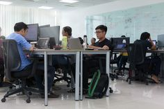 Asian Businessman Sitting At Desk Working Laptop Computer