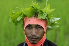 A rice farmer poses for a picture in Udon Thani, Thailand