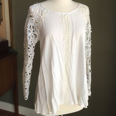 GORGEOUS LACE AND CROCHET DETAIL WHITE TUNIC Button detail down the back. Crochet on the back as well. Just stunning!  Crochet arms and lace detail down front center. Hi-lo cut. Size small. Double Zero Tops Tunics