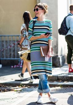 Milan Fashion Week Street Style: striped mid length dress over cuffed jeans with white sneakers. Layering Outfits, Simple Outfits, Work Outfits, Cute Hipster Outfits, Dress Over Jeans, Dress Trousers, Fashion Outfits, Womens Fashion, Fashion Trends