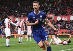 Chelsea's English defender Gary Cahill (C) celebrates after scoring their second goal during the English Premier League football match between Stoke City and Chelsea at the Bet365 Stadium in Stoke-on-Trent, central England on March 18, 2017. / AFP PHOTO / Oli SCARFF / RESTRICTED TO EDITORIAL USE. No use with unauthorized audio, video, data, fixture lists, club/league logos or 'live' services. Online in-match use limited to 75 images, no video emulation. No use in betting, games or single…