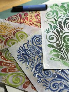 Stenciling embellished with Pitt Pens and then dipped in encaustic medium.