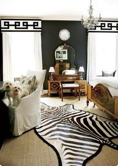 I really like the juxtaposition of the loud zebra rug with the traditional bed and vanity. (Atlanta Homes & Lifestyles)