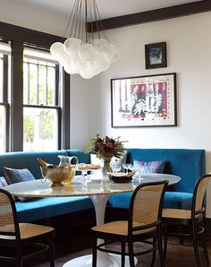 "In the kitchen of young Nashville parents with a new child, Vandiver installed handsome pieces — a custom blue banquette, Josef Hoffmann chairs, a Matisse print, a Saarinen table and an Apparatus light fixture — that he also deemed ""not too precious"" and able to withstand everyday usage."