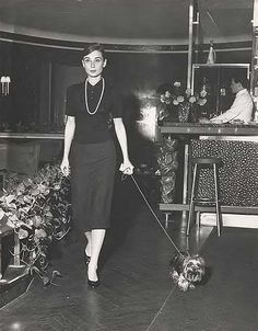 Audrey Hepburn with Mr. Famous (her Yorkshire Terrier) at the famous Hotel Hassler