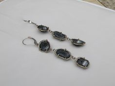 Black & white geodes in hand forged 14K white gold frames are a must!