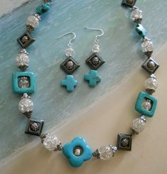 Perfect for summertime necklace and earring set made of turquoise, silver and glass beads.