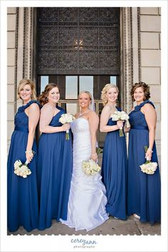 Bridesmaids in long blue dresses with cream rose bouquets in Youngstown Ohio at @stambaugh