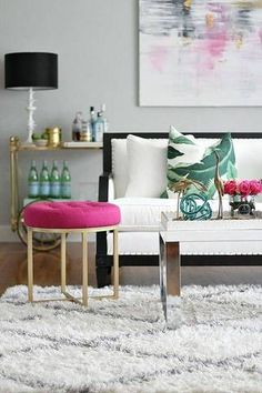Add a cheerful ottoman, the seating that was made for small spaces!