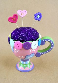 cute idea for using a cup or mug to make a pin cushion.
