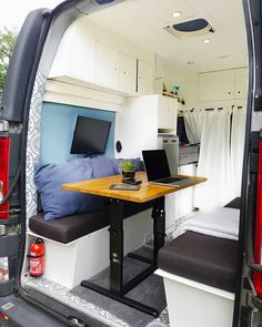 Perfect mobile office setup. This campervan has a great layout for digital nomads and working on the road. I love the organization tips and layout of this DIY van build.