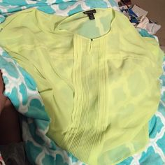 Chiffon Top Beautiful lime green, sheer chiffon top. The fall of the front is loose the back has elastic binding on the bottom so it is versatile when styling your outfits. There is a small snag in pic (priced with consideration of that). Thanks for looking! Lane Bryant Tops Blouses