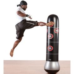 The Pure Boxing MMA Target Punching Bag is designed tough with a unique multi-layer PVC material that can handle your hardest punches and kicks. Ideal for MMA, boxing and martial arts training, the base fills with water or sand for a sturdy boxing target.
