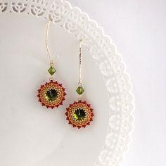 I created this earrings by hand, using 1 olivine Swarovski (12mm) revoli for…
